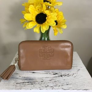 Tory burch tassel accordion  zip around wallet